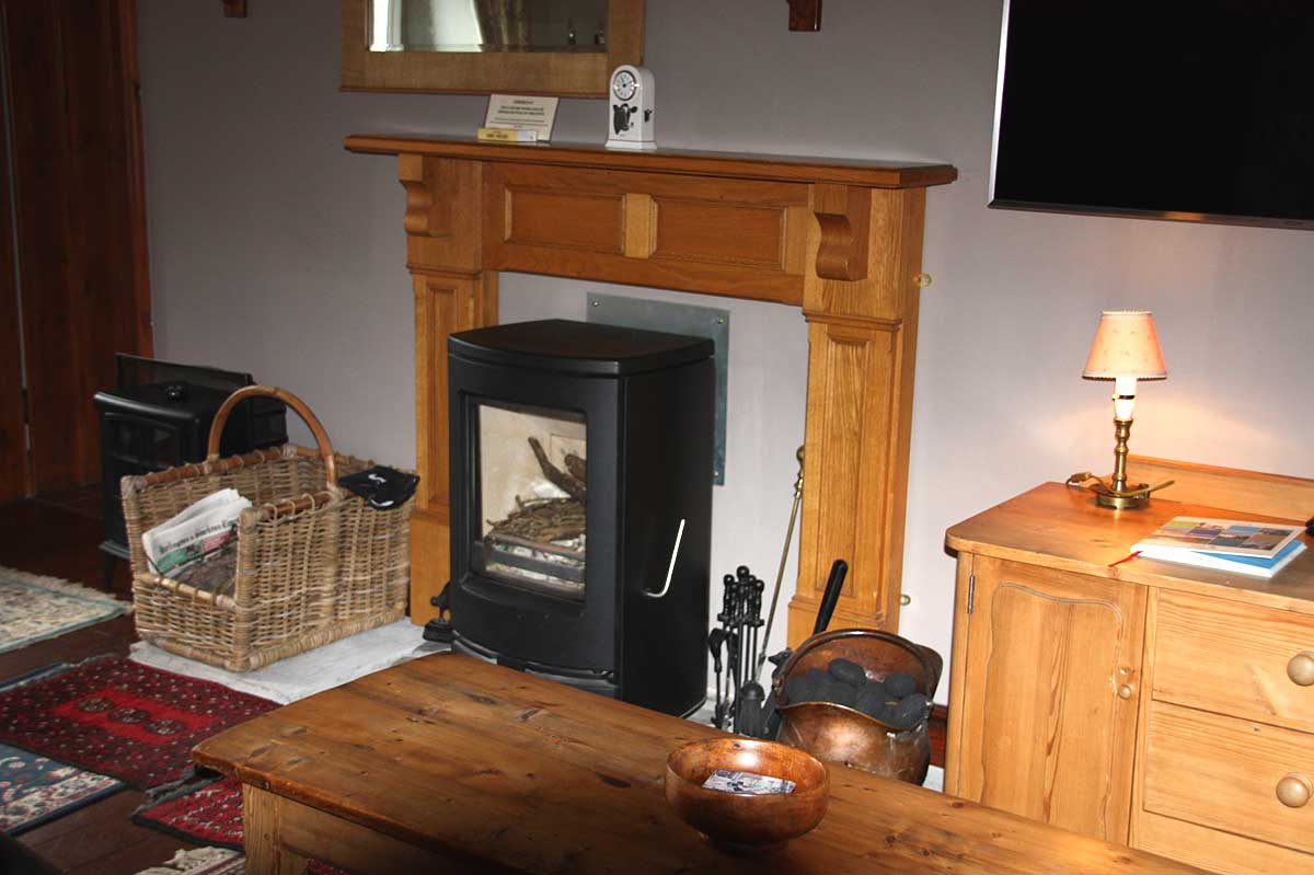 Cosy traditional living room with wood burning stove